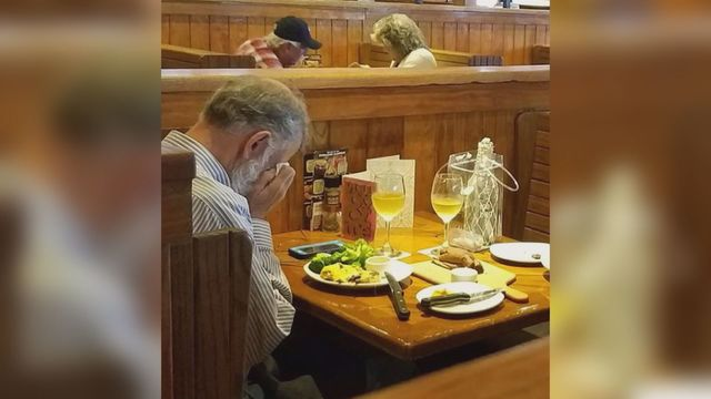 Heartbreaking photo of man sitting alone at Valentine's lunch date with wife's ashes