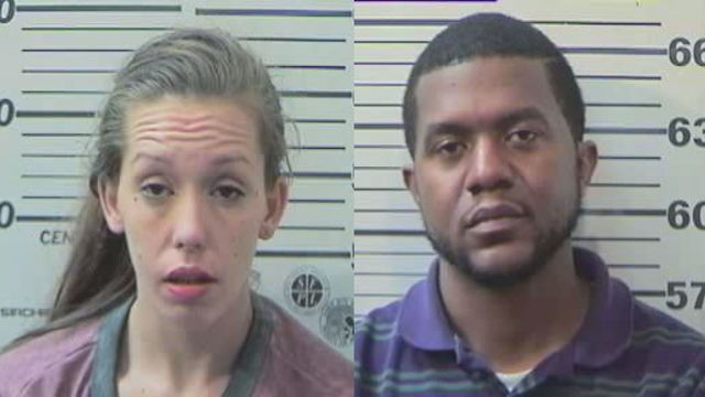 Two arrested for passing out fake money at local men's club