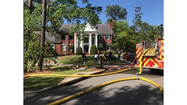 Mobile Firefighter transported to hospital following house fire