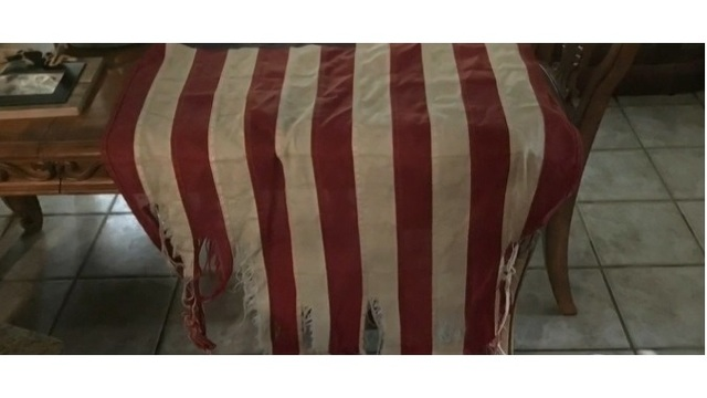 Army veteran fired after removing tattered American flag