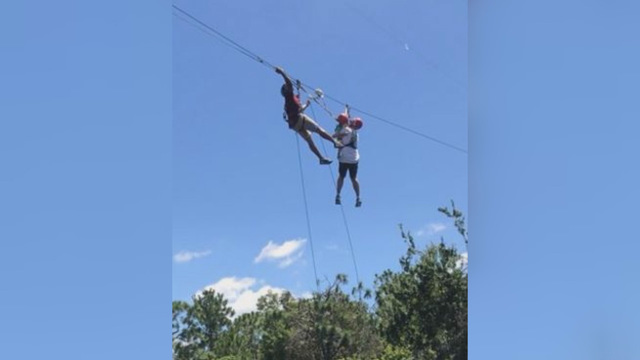 Man and child get stuck on zipline above gators at Gatorland
