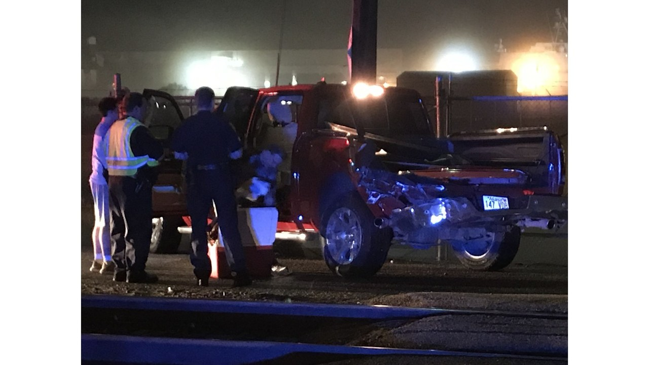 Image result for Car hit by train on tracks near Mobile cruise terminal