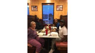 Alabama men spot elderly woman eating alone, and invite her to join them
